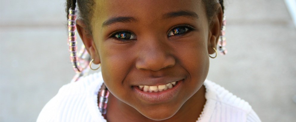 Girl smiling with braid beads