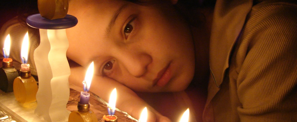 Youth staring at candles
